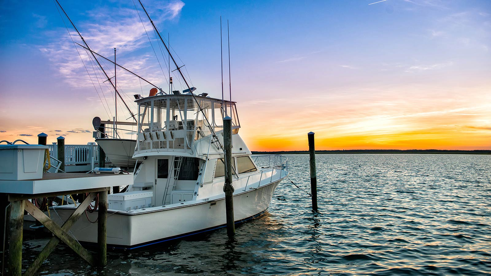 sportfishing yacht at sunset